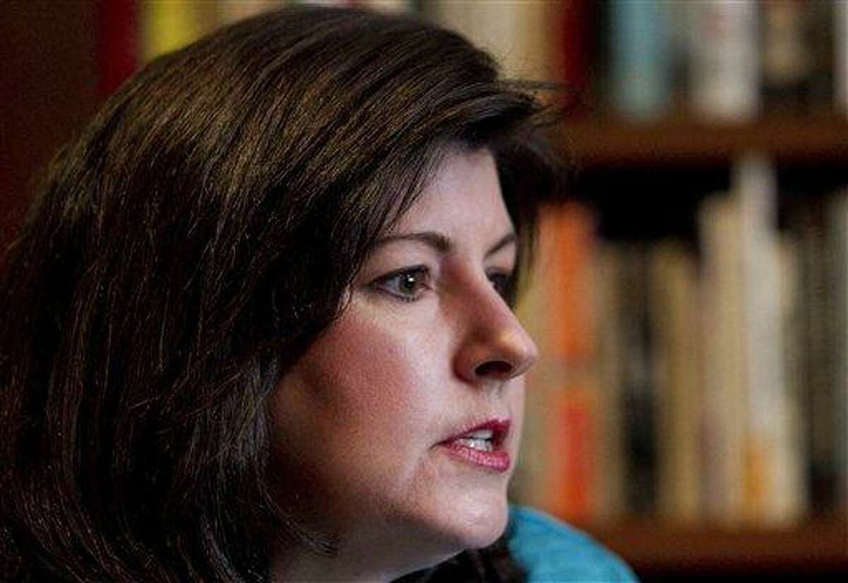 In this Feb. 7, 2012, photo, Karen Handel speaks during an interview in Atlanta. All of a sudden, abortion, contraception and gay marriage are at the center of American political discourse, with the struggling _ though improving _ economy pushed to the background. Social issues don?t usually dominate the discussion in shaky economies. Supporters of Planned Parenthood, which provides abortion services, helped force the resignation of Susan G. Komen For the Cure executive Handel after the breast cancer research group cut grants to the organization, then reversed course. Associated Press