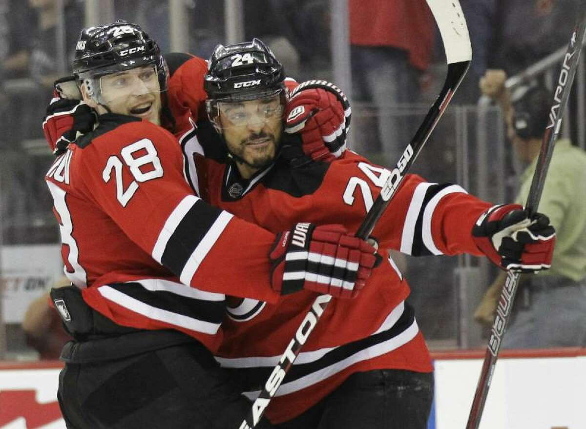 ASSOCIATED PRESS New Jersey Devils' Bryce Salvador, right, celebrates with Anton Volchenkov after scoring in the second period during Game 5 of the Stanley Cup finals Saturday in Newark, N.J. The Devils won to force a Game 6.