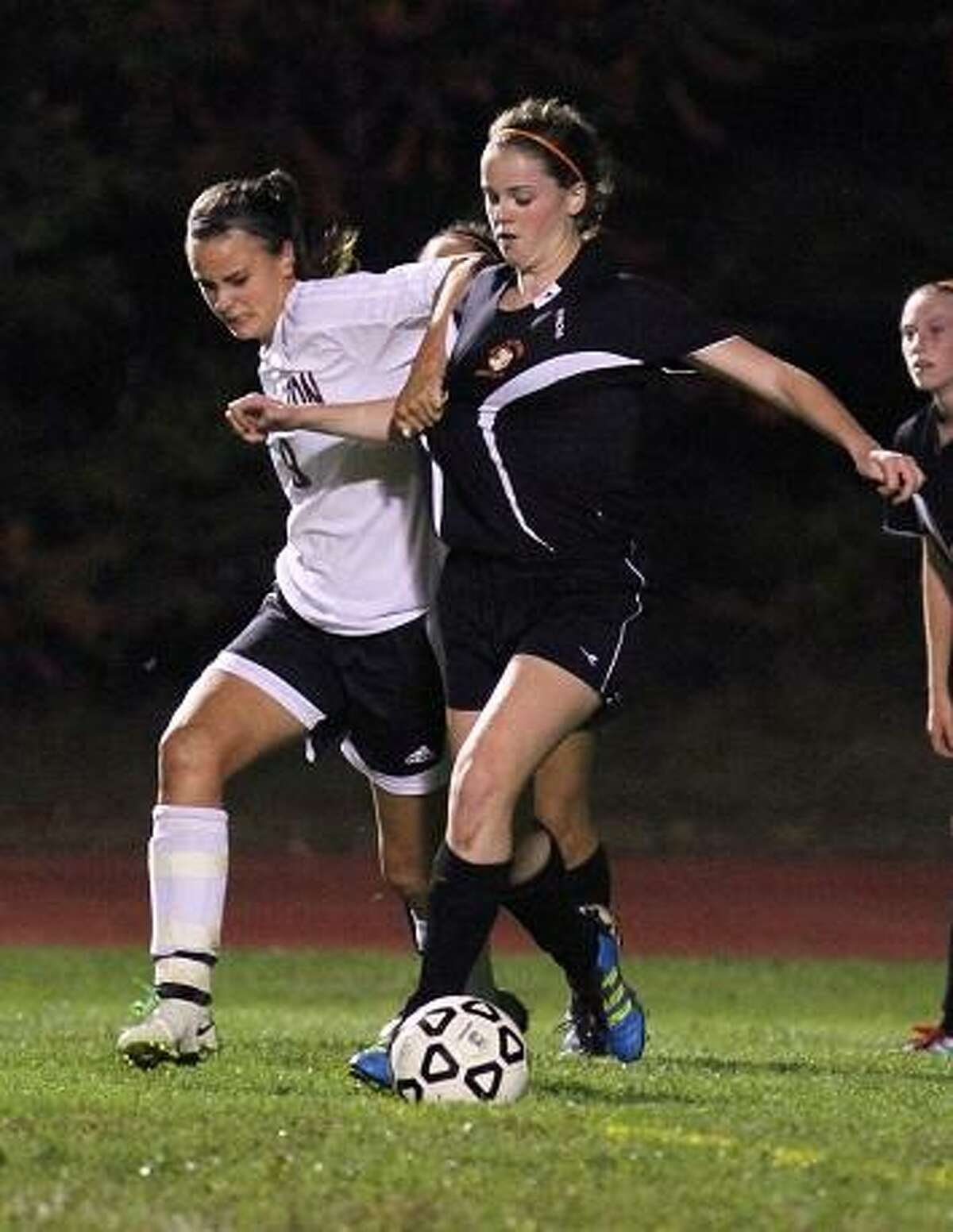 MARIANNE KILLACKEY/REGISTER CITIZEN Olivia Morrison of the Lady Raiders battles for the ball against Watertown's Amy Lamontagne.