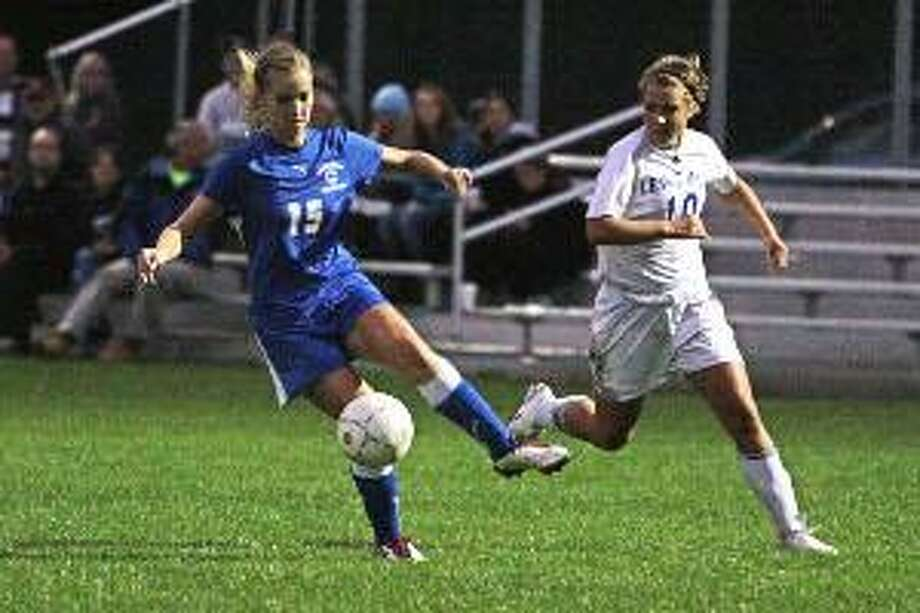 JENNIFER ROYALS/Register Citizen Correspondent Nonnewaug's Cassidy High dribbles past Lewis MIlls' Paige Marinelli during the Chiefs' 2-0 win over the Spartans in Burlington Tuesday night. Nonnewaug remains unbeaten on the season (7-0) and has outscored its opponents 40-0.