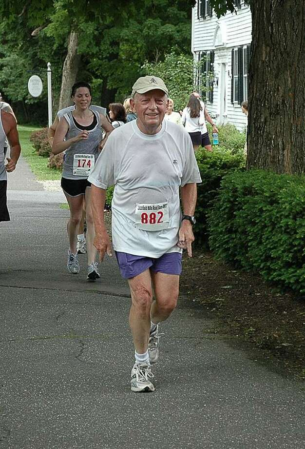 Robert Wilton runs the last mile of the Litchfield Hills Road Race up South Street in 2007. (Photo courtesy Amy Wilton)