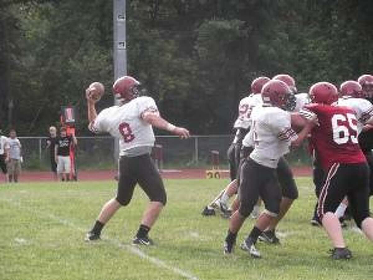 KEVIN D. ROBERTS/Register Citizen Torrington senior quarterback Phil Bresson drops back to pass during the Red-White scrimmage on Friday at Torrington High School.