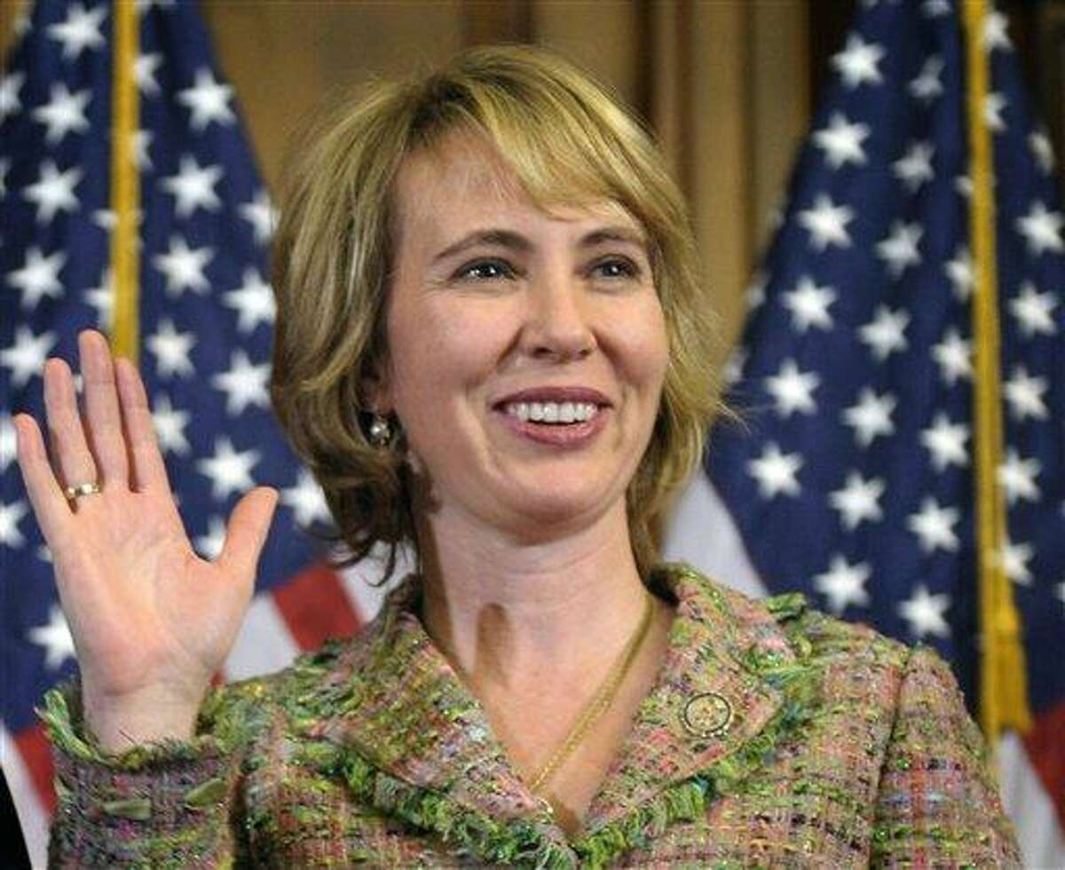 FILE - In this Jan. 5 file photo, Rep. Gabrielle Giffords, D-Ariz., takes part in a reenactment of her swearing-in on Capitol Hill in Washington. An aide to Giffords says the Arizona congresswoman could soon be released from her rehabilitation hospital in Houston. Giffords was shot in the head as she met with constituents in Tucson, Ariz. Six people were killed in the Jan. 8 shooting and Giffords was among 13 people who were wounded. (AP Photo/Susan Walsh, File)