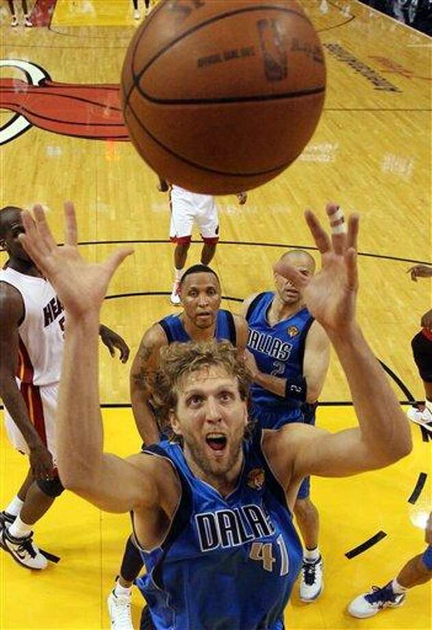 Dallas Mavericks' Dirk Nowitzki goes up for a rebound during the second half of Game 6 of the NBA Finals basketball game against the Miami Heat Sunday in Miami. (AP Photo/Ronald Martinez; Pool) Photo: AP / Getty Images; Pool
