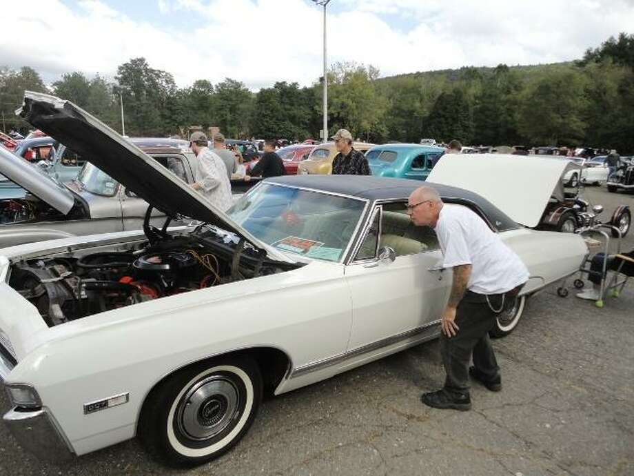 """JASON SIEDZIK/ Register Citizen Classic car collectors of all stripes came together for Cartoberfest 2011, held at Collinsville Antiques on Sunday. To purchase a glossy photo of this picture, visit <a href=""""http://registercitizen.com"""">registercitizen.com</a>."""