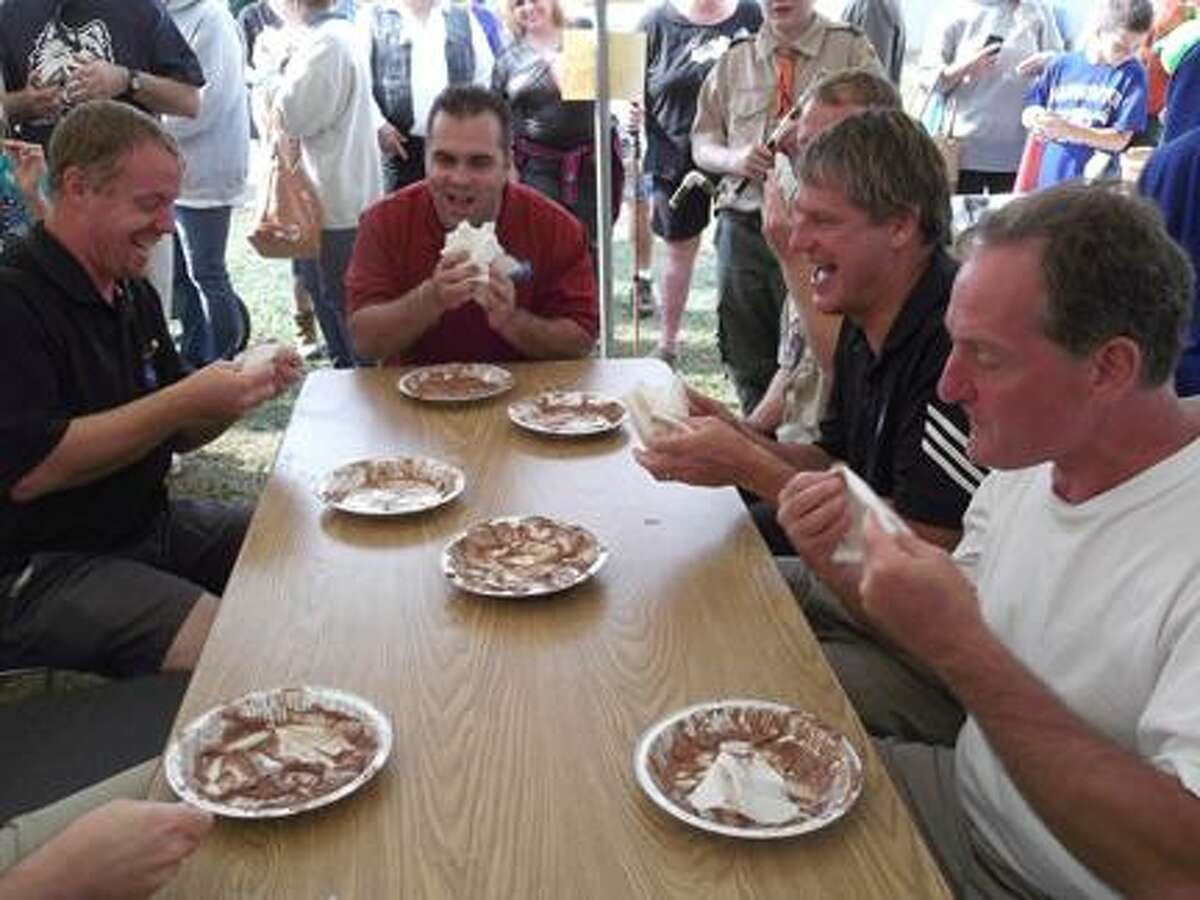 A group of Republican leaders took some time out of their Saturday to enjoy the Harwinton Fair and take part in a pie eating contest at the Boy Scouts of America tent. Visible pie eaters (clockwise) Harwinton selectmen John Truskauskas, Michael Criss, State Sen. Kevin Witkos and State Rep. John Piscopo.