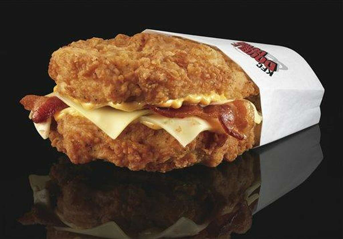 FILE - This undated file product image provided by KFC shows their new Double Down sandwich. The Double Down is essentially a sandwich with two chicken filets taking the place of bread slices. In between are two pieces of bacon, melted slices of Monterey Jack and Pepper Jack cheese and a zesty sauce. (AP Photo/KFC, Dan Kremer, File)