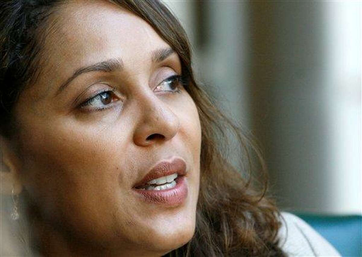 Pulitzer Prize winning author Natasha Trethewey recalls her young years in Mississippi, during a break in her speaking schedule in October 2007 at Delta State University in Cleveland, Miss. Trethewey will be named the Library of Congress' 19th poet laureate Thursday. Associated Press