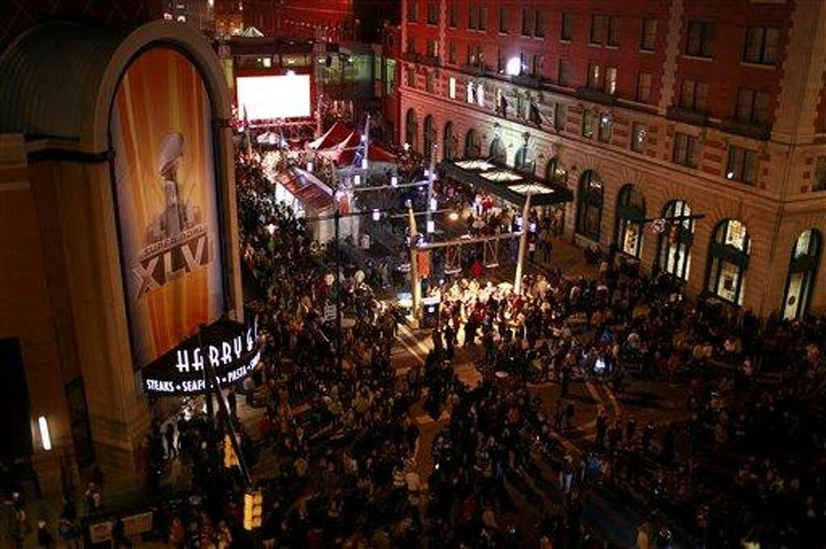 People crowd the streets through Super Bowl Village last week in Indianapolis. Associated Press
