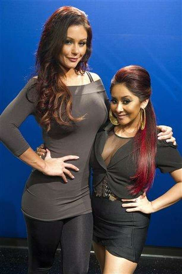 "Jenni ""JWoww"" Farley, left, and Nicole ""Snooki"" Polizzi pose for a portrait in New York Wednesday. Associated Press Photo: AP / FR170266 AP"