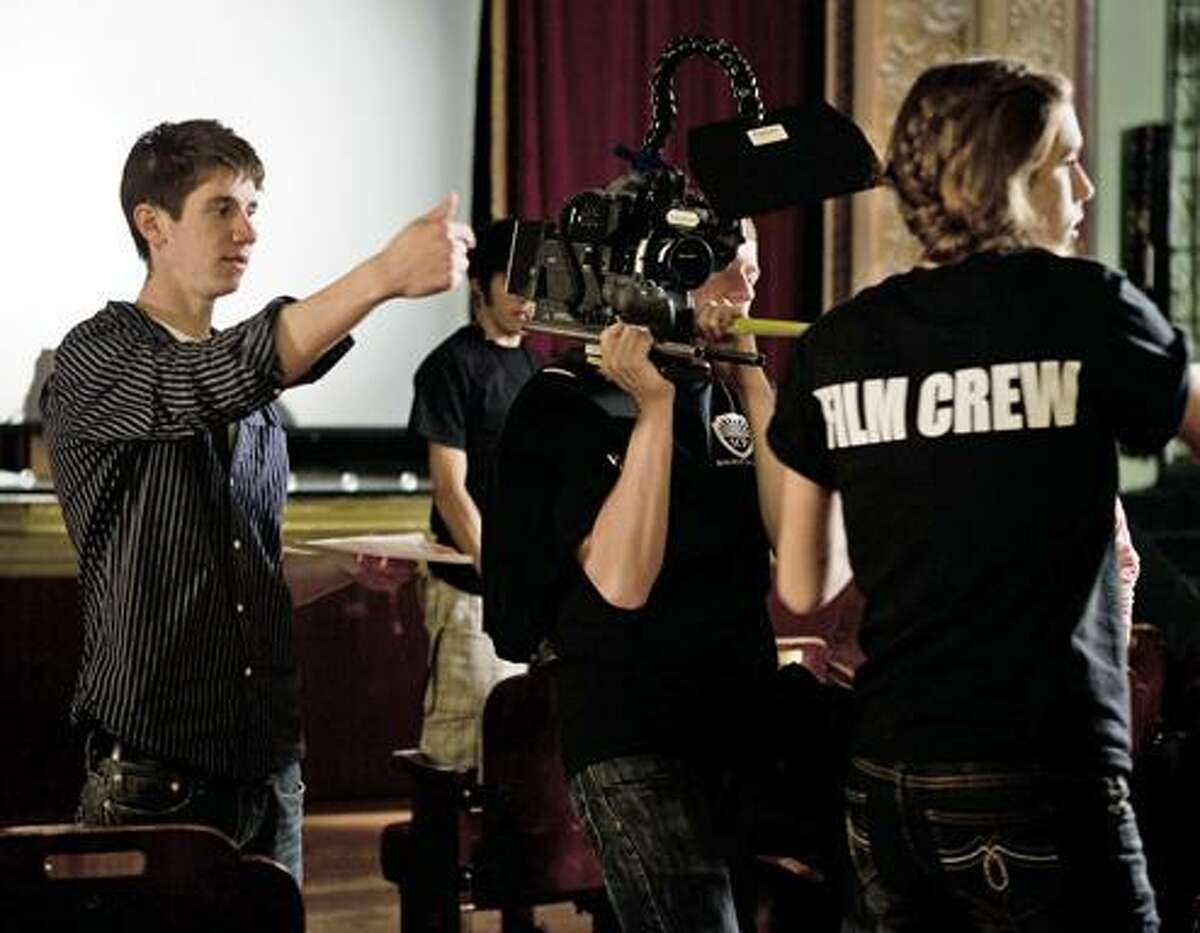 2008 Torrington High School graduate Jaron Downs directs the actors and my cinematographer Mark Davis getting measurements for focus for his short film,