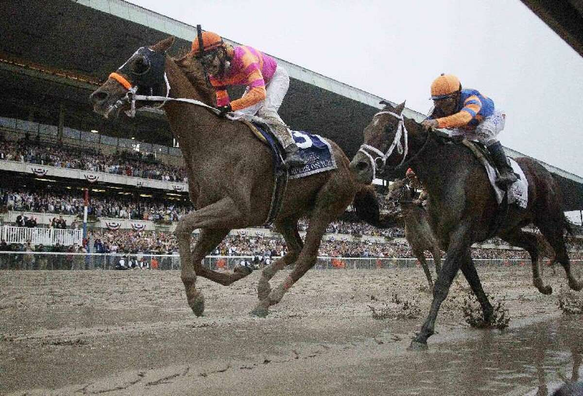 ASSOCIATED PRESS Ruler On Ice, left, with jockey Jose Valdivia Jr., sprints ahead of jockey Javier Castellano on Stay Thirsty to win the Belmont Stakes horse race Saturday at Belmont Park in Elmont, N.Y.