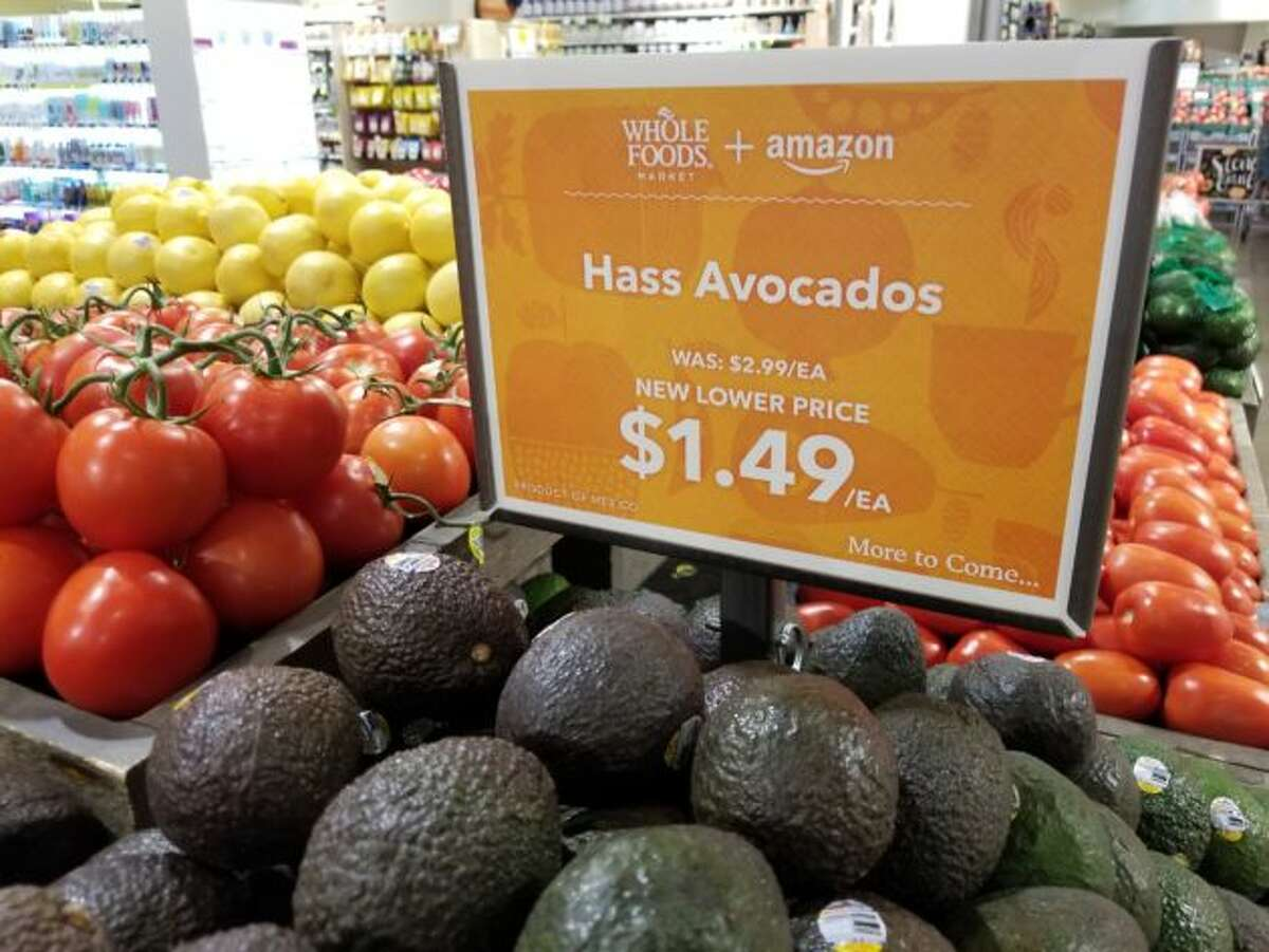 Amazon cut the price of avocados by 50 percent at the Whole Foods Market in Seattle's South Lake Union neighborhood.