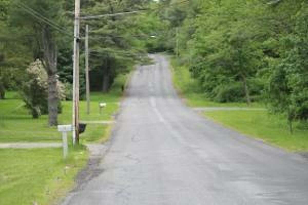 TIMOTHY W. GAFFNEY/Register Citizen Correspondent The famous, or infamous, Gallows Lane hill is shown. The 35th annual Litchfield Hills Road Race is today. Runners looking to win the title will have to battle their way over this hill.