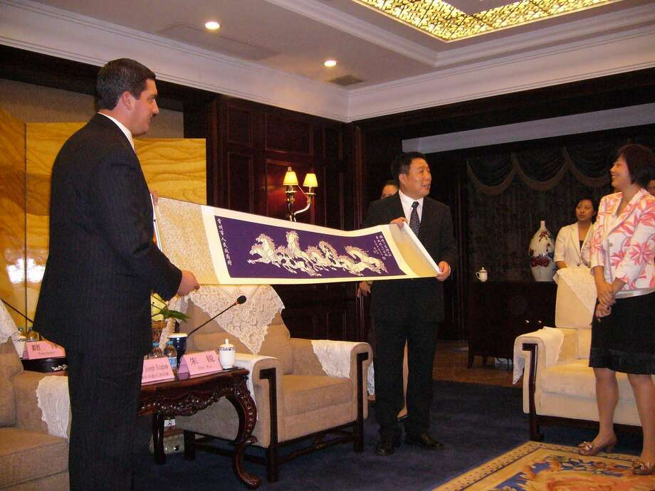 Contributed Mayor Ryan Bingham, left, holds a banner with the Changzhou City Mayor during a recent trip to China. Bingham went to China to further the Sister-City relationship Torrington has with Changzhou.