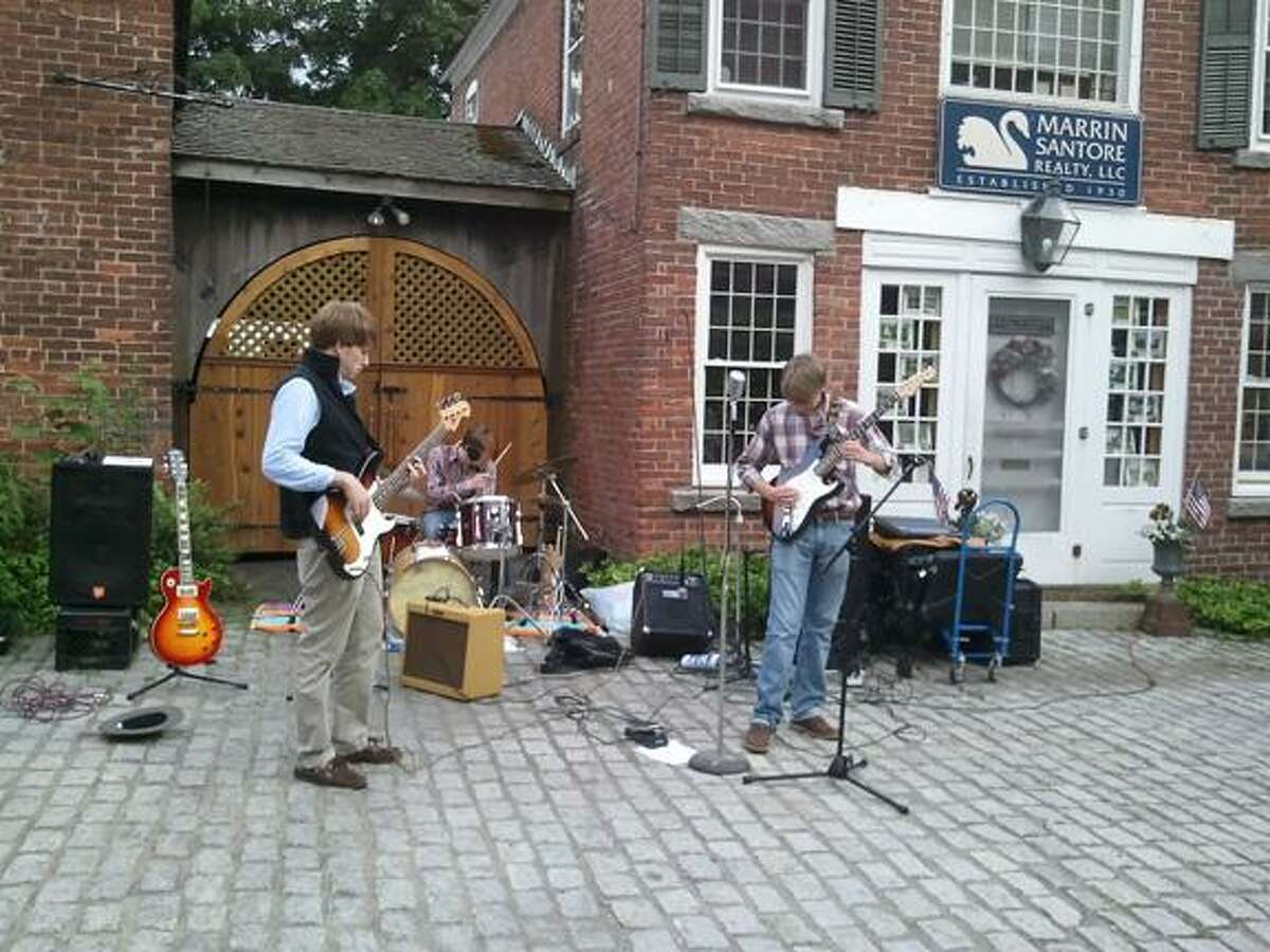 The Revival jams some rock tunes to an audience in Cobble Court.