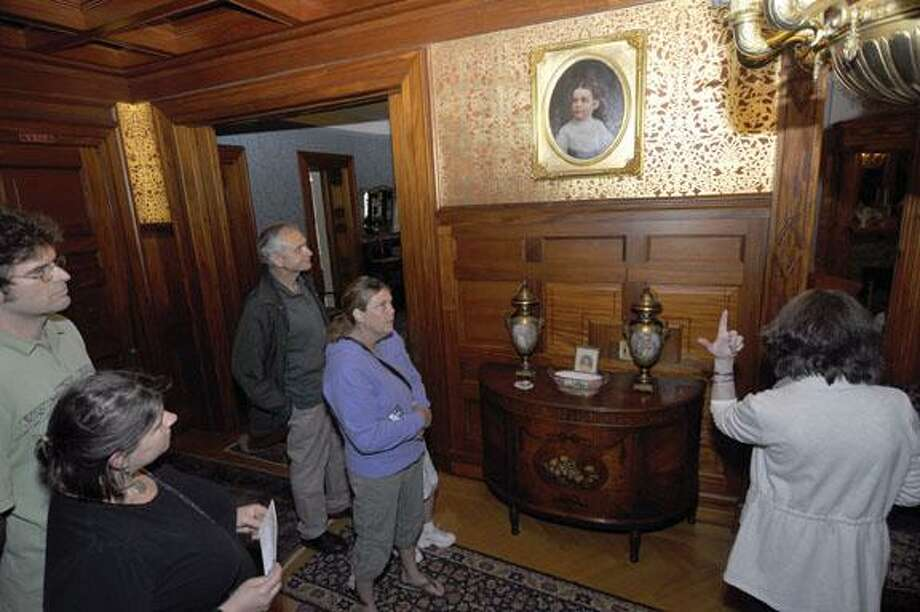 RICK THOMASON / Register CitizenLocal history buffs get a tour of the Hotchkiss-Fyler House during Saturday's open house of the Torrington Historical Society. The stream of visitors was constant through both the house and the Torrington Hisotrical Museum next door.
