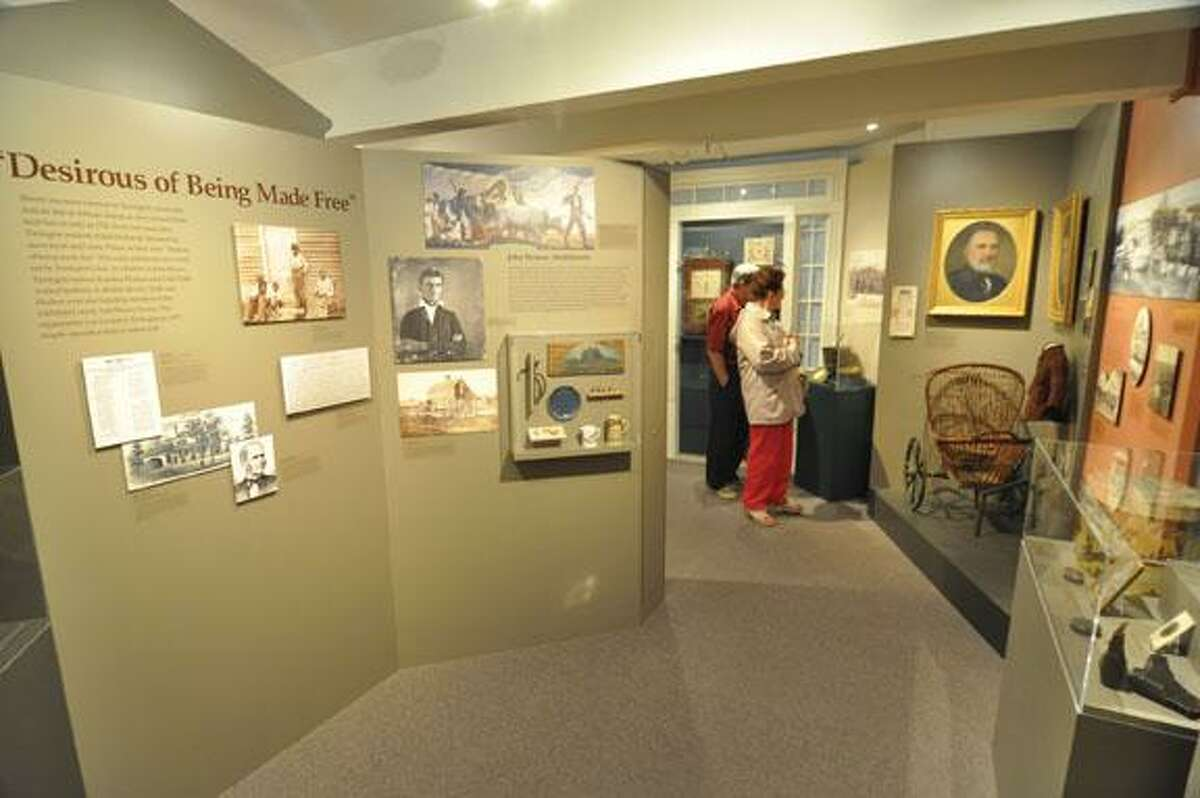 RICK THOMASON / Register CitizenA couple takes a stroll through the Torrington Historical Society Museum during Saturday's free open house. Dozens walked through the museum and the Hotchkiss-Fyler House to glimpse Torrington's rich and storied history.