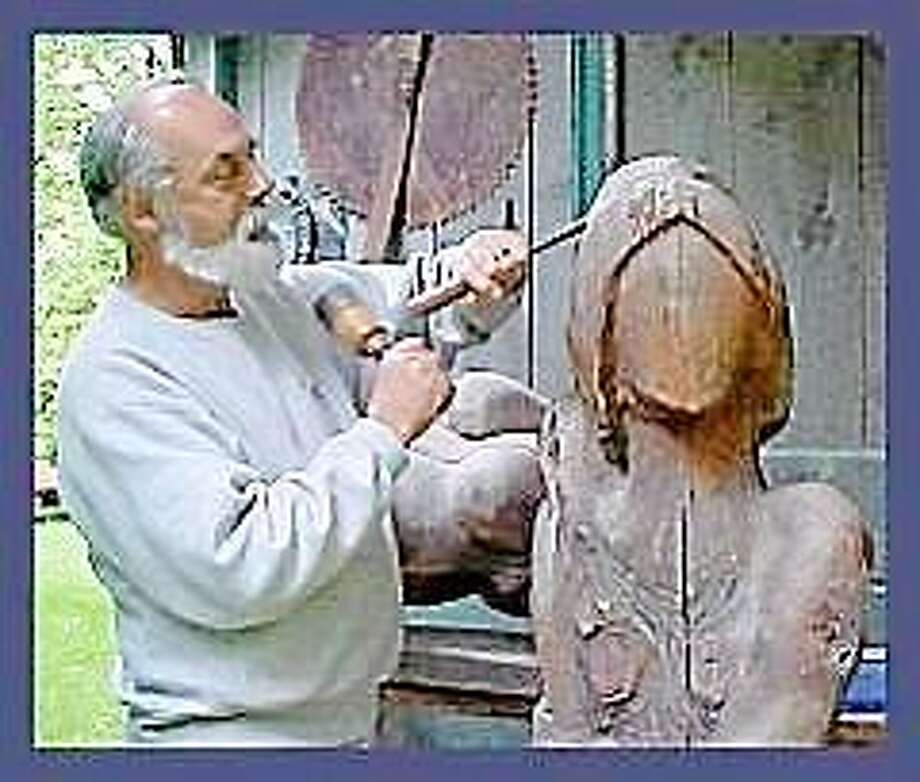 Ernie working on a sculpture.