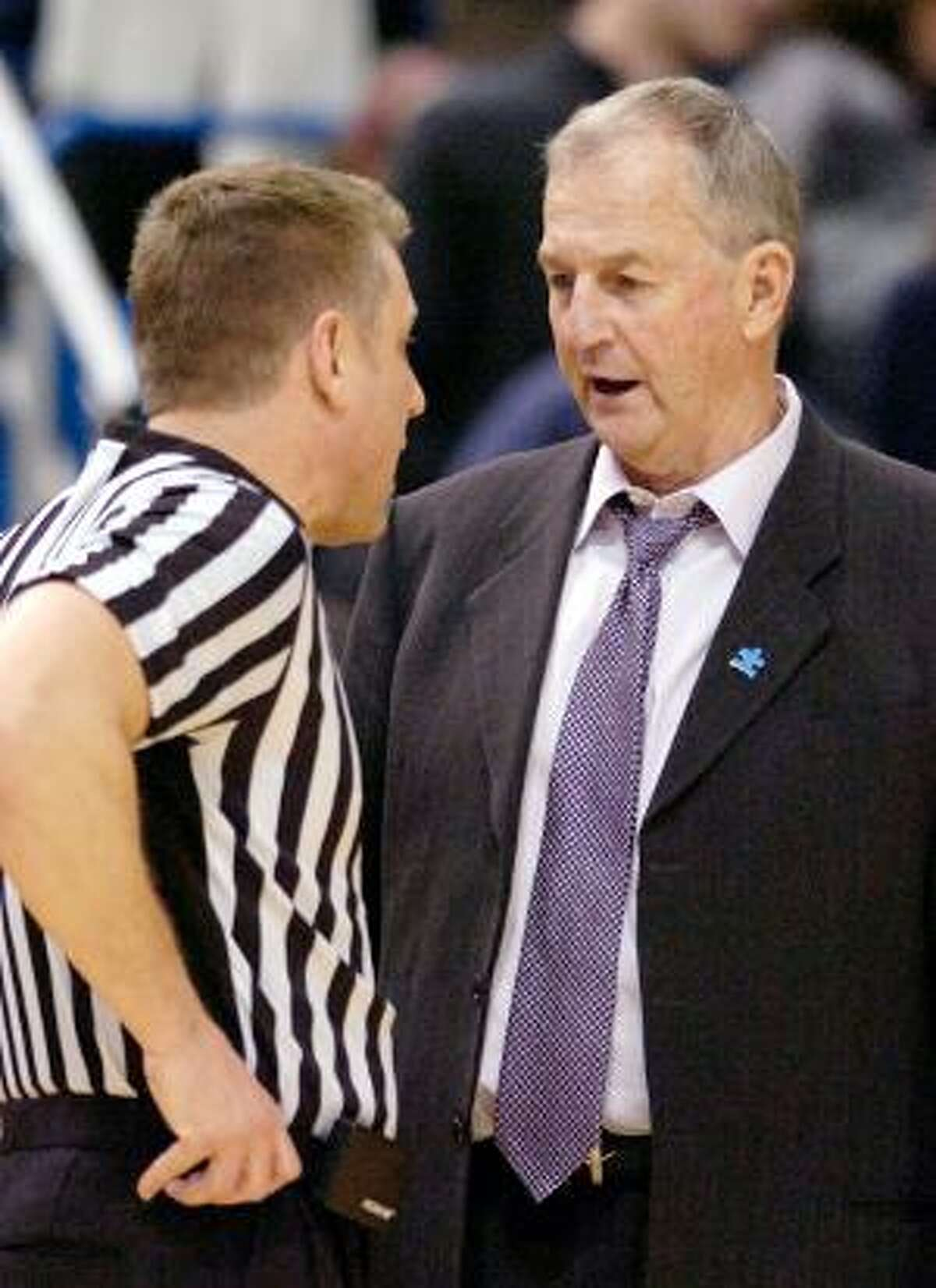 AP Connecticut coach Jim Calhoun speaks with an official during the first half of his team's 78-70 victory over Georgetown on Feb. 16 in Hartford. Calhoun released a statement Friday responding to the NCAA's findings and said