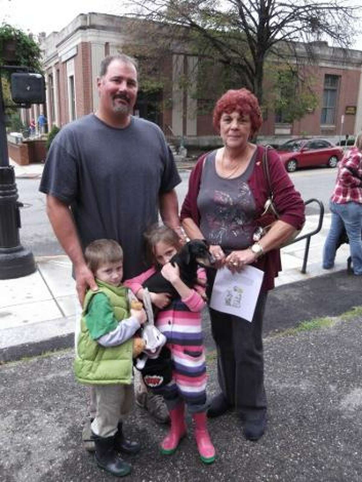 KAITLYN YEAGER/Register Citizen Dog family: Richard Ricupero and his children Isabella and Nicholas wait with Grandma Kenneson and their dog Blackie for the Blessing of the Animals to begin at St. Francis Church. This year's event was the second blessing and first pet parade for the church.