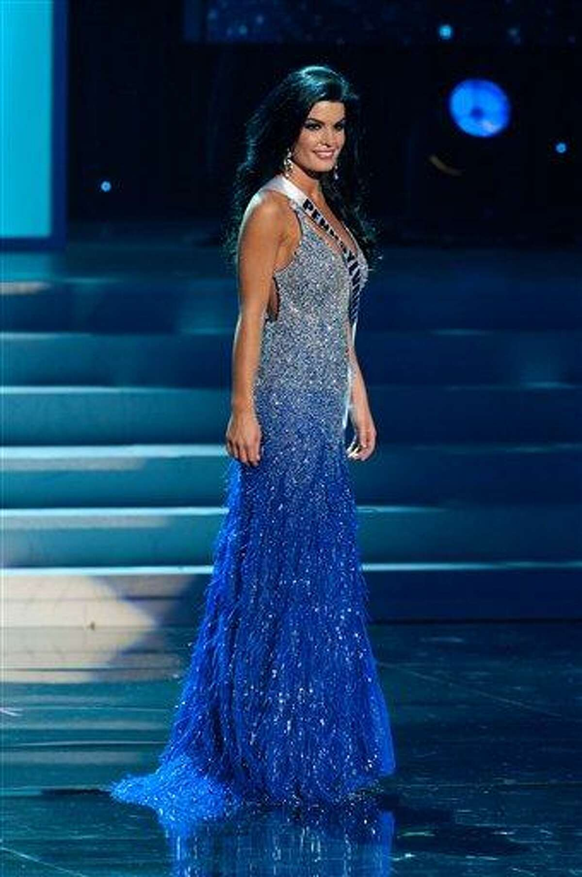 In this photo provided by the Miss Universe Organization, Miss Pennsylvania Sheena Monnin competes during the 2012 Miss USA Presentation Show on Wednesday in Las Vegas. Monnin resigned her crown claiming the contest is rigged, but according to organizers the beauty queen was upset over the decision to allow transgender contestants to enter. A posting on Monnin's Facebook page claims another contestant learned the names of the top 5 finishers on Sunday morning, hours before the show was broadcast. Associated Press
