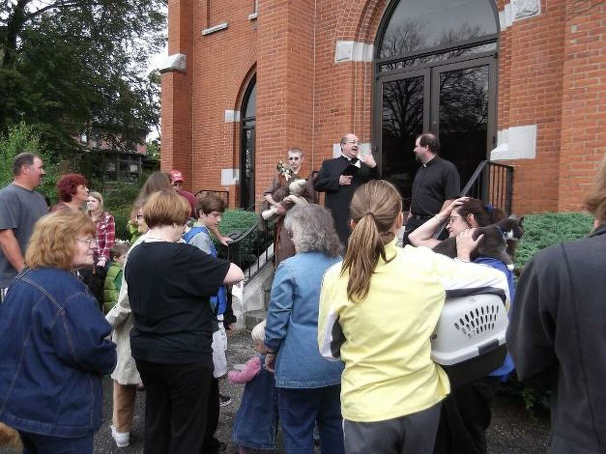 KAITLYN YEAGER/Register Citizen Several species of animals, from cats and dogs to a lizard and a sugar glider, were brought to St. Francis Church on Torrington for the second annual Blessing of the Animals event Saturday.