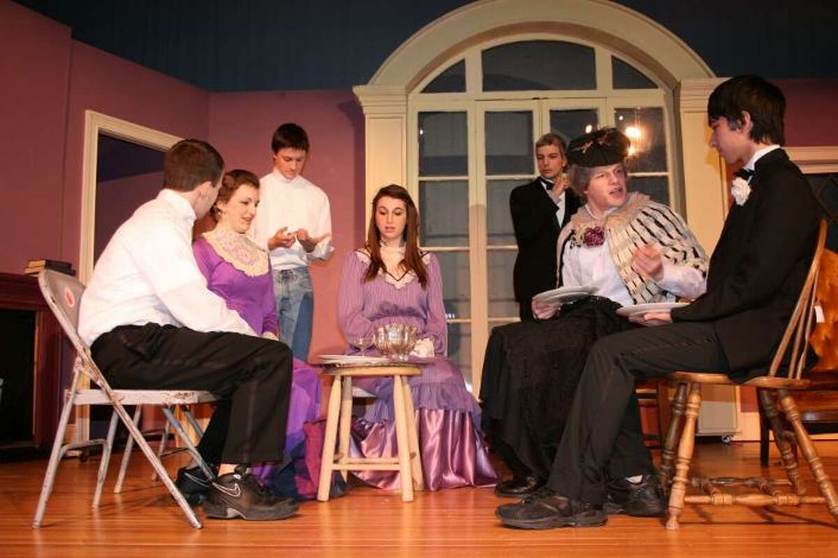 Torrington High School students rehearse a scene from the comedy