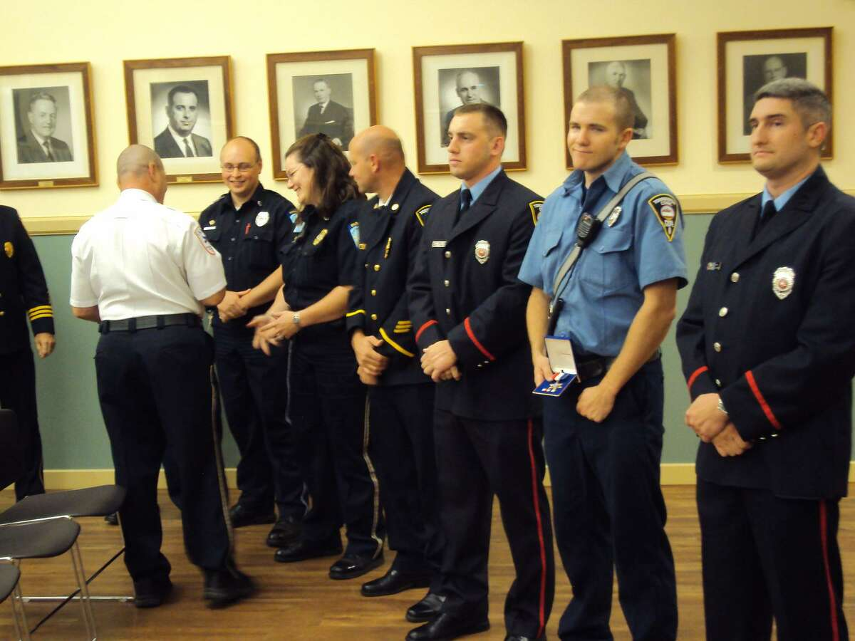 RICKY CAMPBELL/ Register Citizen During Wednesday's Board of Public Safety meeting, members of the Torrington Fire Department and Campion Ambulance were recognized with Life Saving Awards for their heroics during a recent cardiac arrest. According to Acting Fire Chief Gary Brunoli, the recognition for the cardiac save highlights the hard work the employees put into the city.