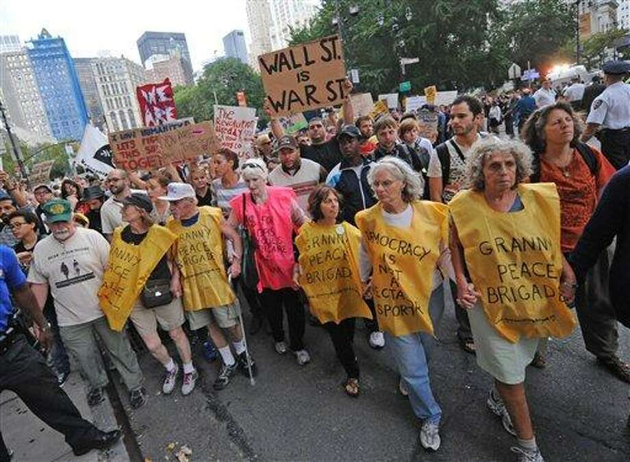 """An elderly group leads a march up Broadway towards Police Headquarters, Friday, Sept. 30, 2011, in New York. The """"Occupy Wall Street"""" protest is in its second week, as demonstrators speak out against corporate greed and social inequality. Photo: AP / FR77522 AP"""