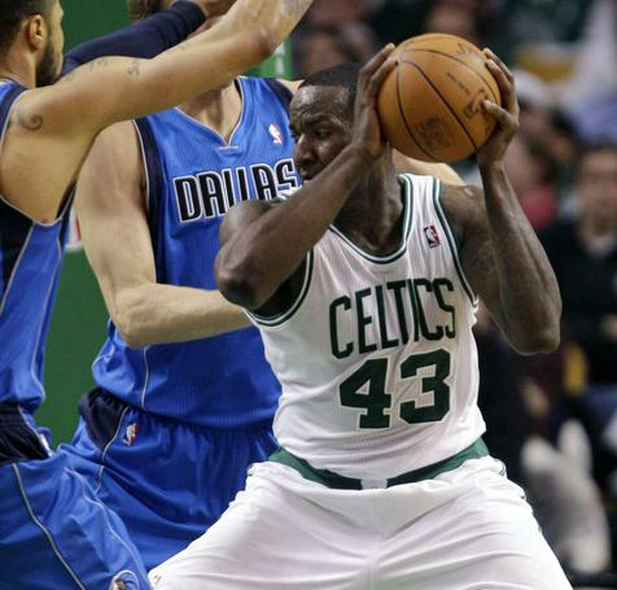 Boston Celtics center Kendrick Perkins (43) can not find his way through the Dallas Mavericks defense to the basket during the second half of their NBA basketball game at the Garden in Boston, Friday, Feb. 4, 2011. The Mavericks defeated the Celtics 101-97. (AP Photo/Stephan Savoia)