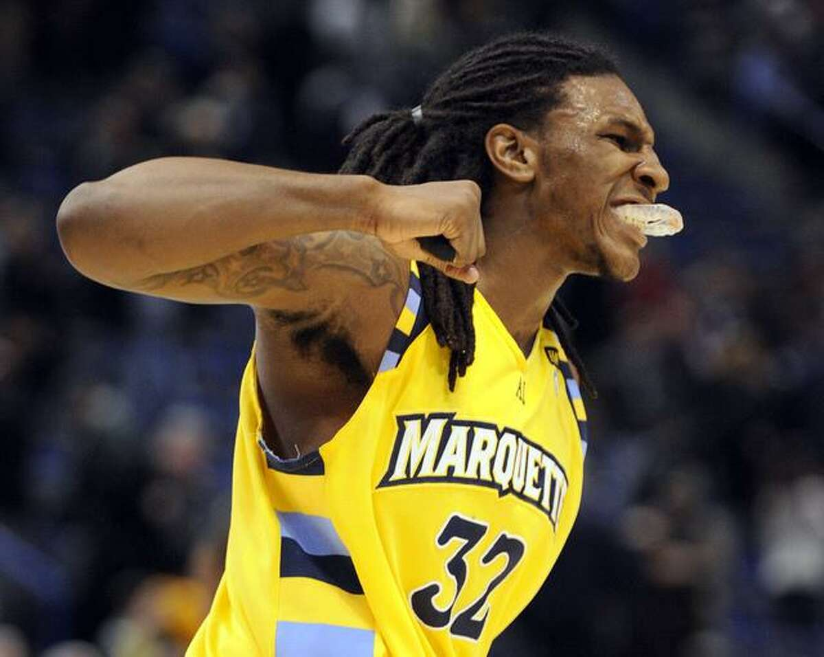 Marquette's Jae Crowder celebrates after his team's 74-67 overtime victory against Connecticut in an NCAA college basketball game in Hartford, Conn., on Thursday, Feb. 24, 2011. (AP Photo/Fred Beckham)