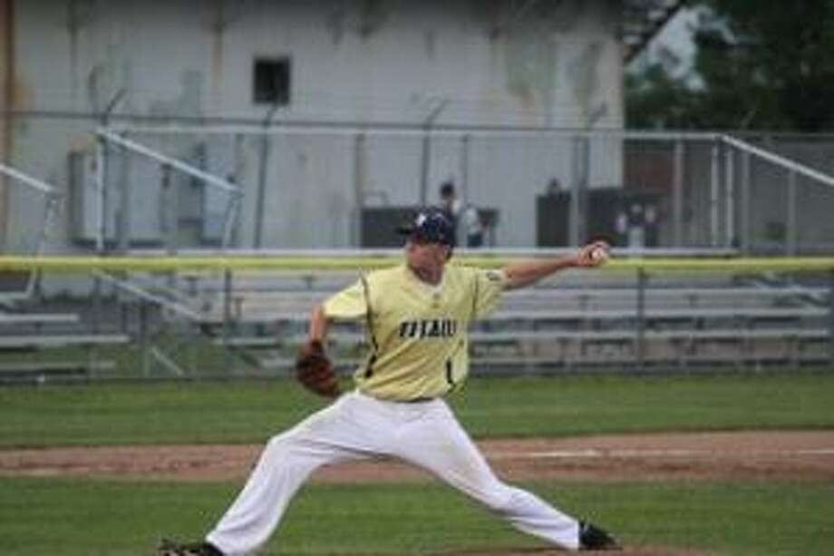 TIMOTHY W. GAFFNEY/Register Citizen Correspondent Torrington Titans pitcher Kevin Bartlett delivers during the team's home opener against the Nashua Silver Knights Friday night at Fuessenich Park in Torrington. The Titans lost 10-1.