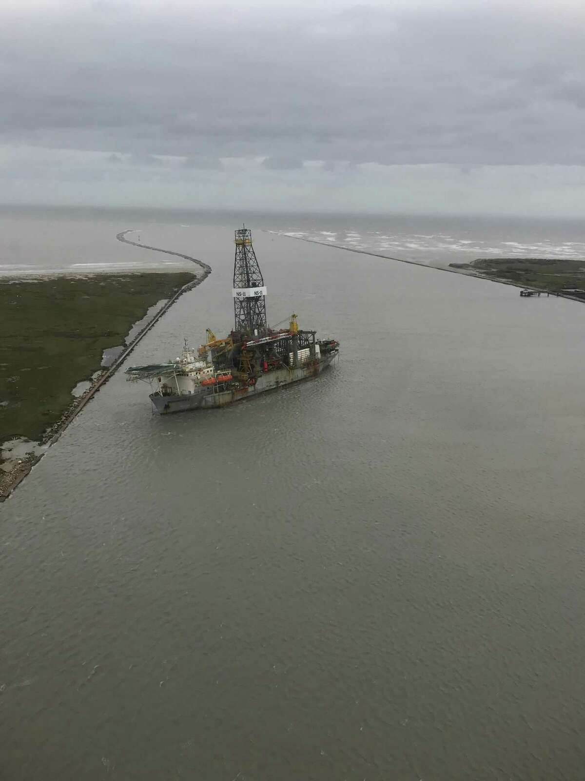 The Paragon DPDS1 drilling ship sits beached near the outlet to the Gulf of Mexico after being ripped from its mooring during Hurricane Harvey.