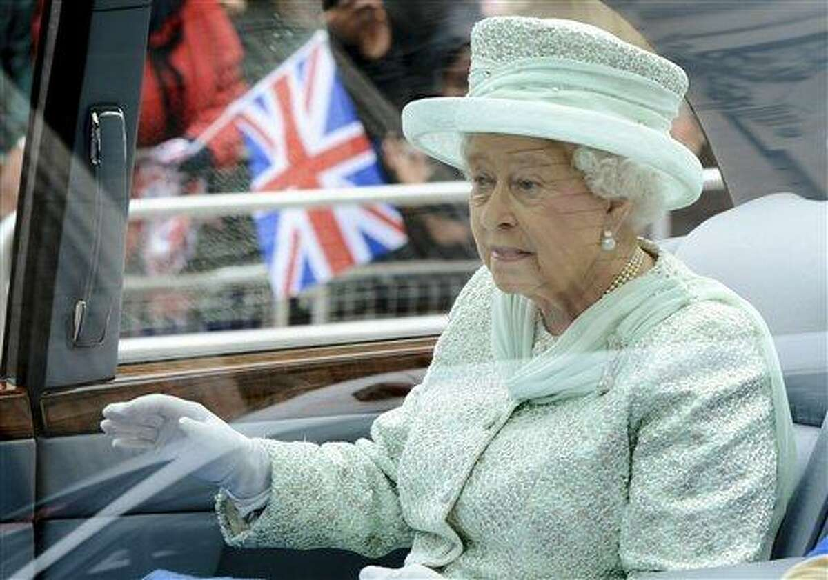 Britain's Queen Elizabeth II departs from the Diamond Jubilee service of thanksgiving at St Paul's Cathedral in London Tuesday. Crowds cheering