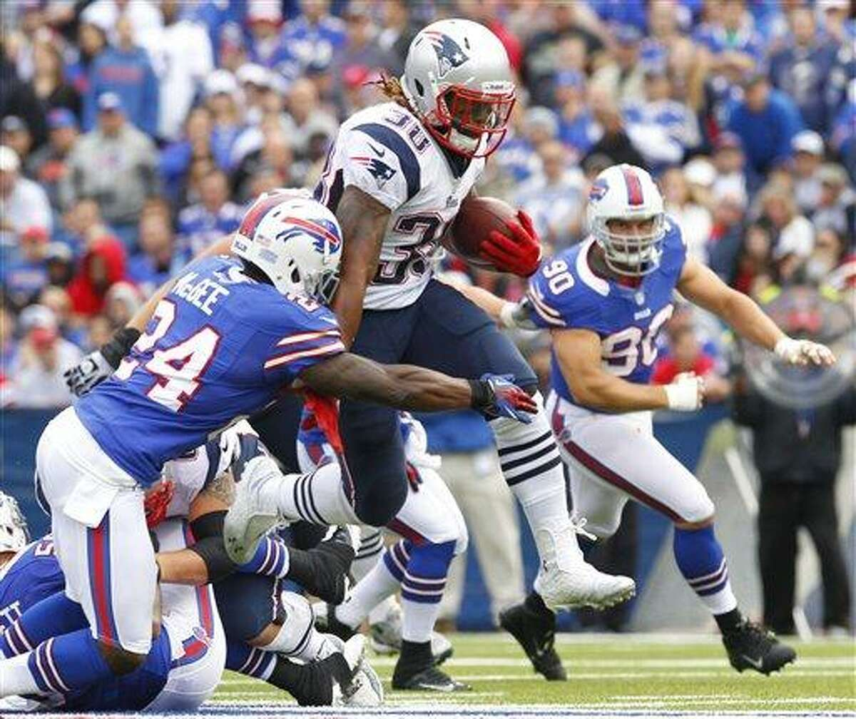 New England Patriots' Brandon Bolden (38) tries to run through the tackle of Buffalo Bills' Terrence McGee (24) during the second half of an NFL football game in Orchard Park, N.Y., Sunday, Sept. 30, 2012. (AP Photo/Bill Wippert)
