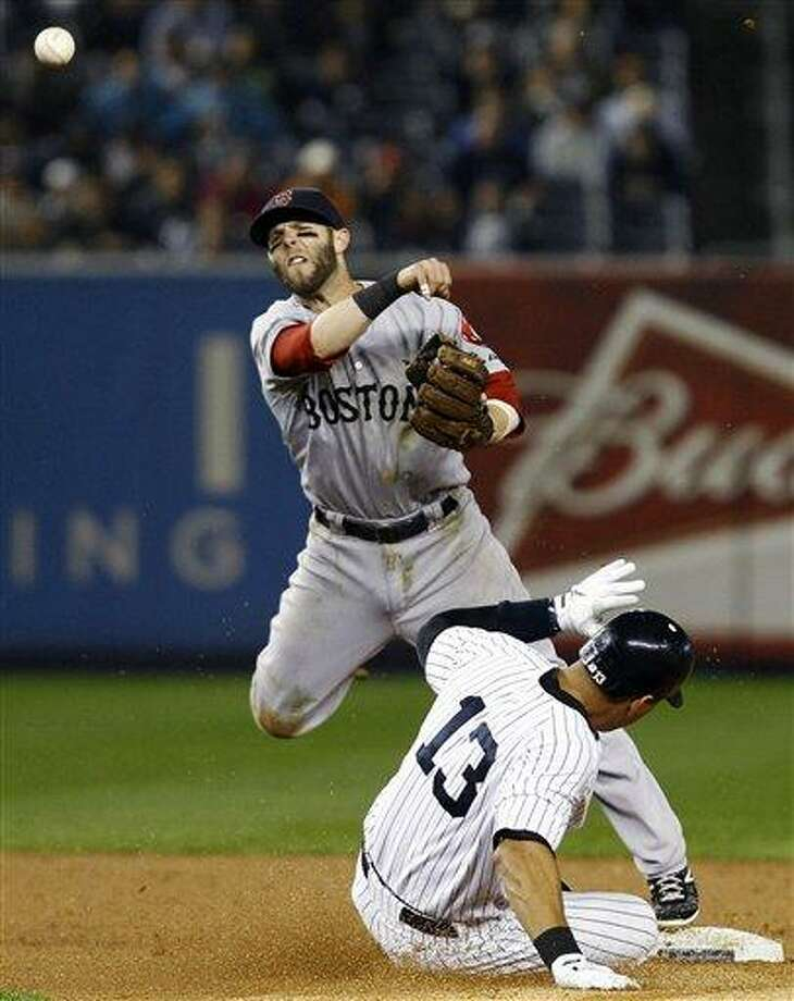 Boston Red Sox second baseman Dustin Pedroia throws to first after forcing out New York Yankees' Alex Rodriguez (13) to complete a double play during the first inning of their baseball game at Yankee Stadium in New York, Tuesday, Oct. 2, 2012. Yankees' Mark Teixeira hit into the play. (AP Photo/Kathy Willens) Photo: AP / AP