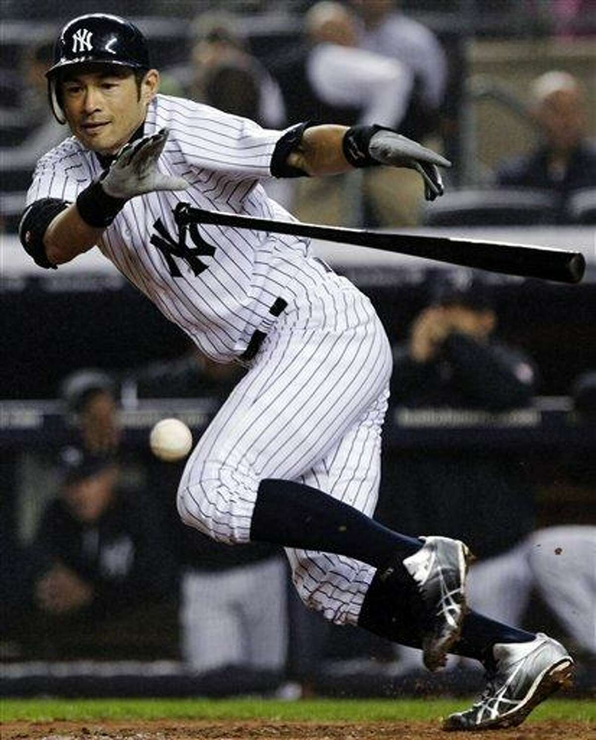New York Yankees' Ichiro Suzuki, of Japan, bunts during the fifth inning of a baseball game against the Boston Red Sox, Tuesday, Oct. 2, 2012, in New York. Suzuki was safe at first on the play. (AP Photo/Frank Franklin II)