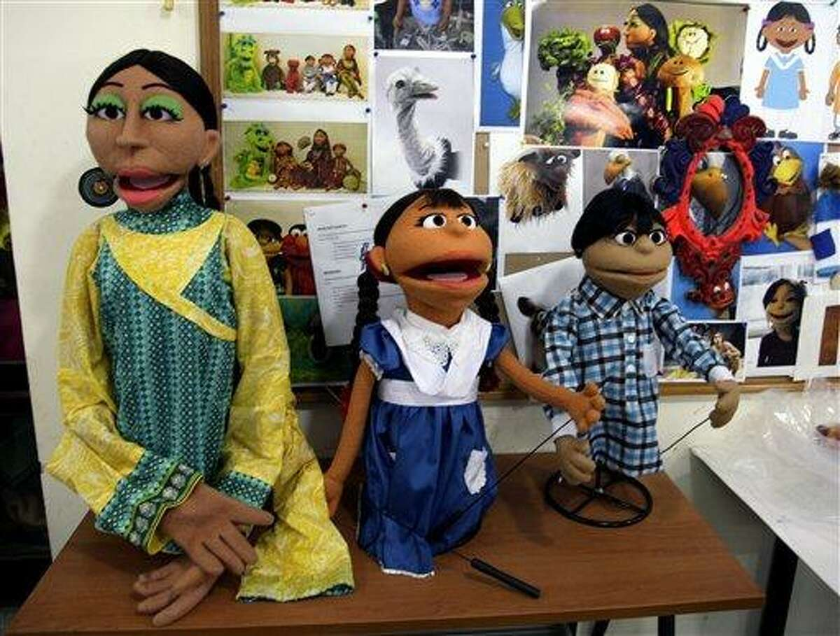 In an Thursday, Oct. 13, 2011 photo, characters of Pakistani Sesame Street are displayed in Lahore, Pakistan. The U.S. Embassy in Pakistan says it terminated funding for a $20 million project to develop a local version of Sesame Street amid reports of corruption. Embassy spokesman Robert Raines said Tuesday, June 5, 2012, the U.S. terminated funding but declined to provide details. (AP Photo/K.M.Chaudary, file)