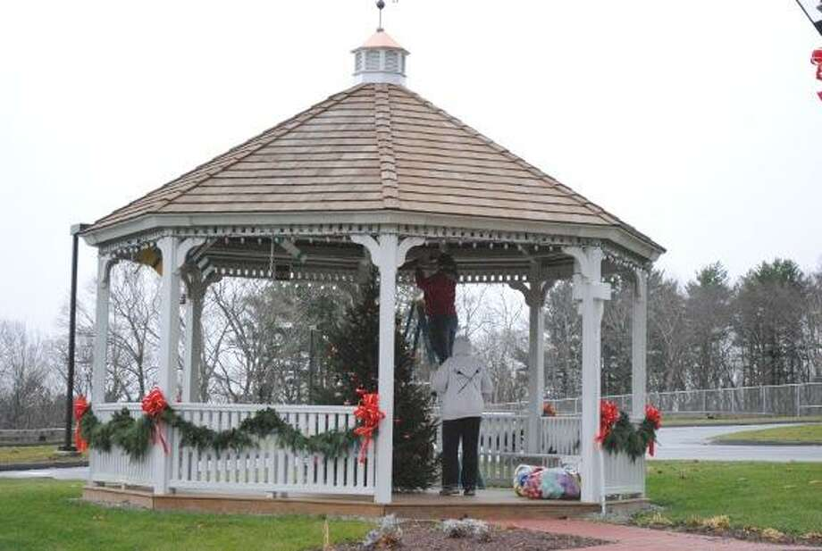 MIKE AGOGLIATI/ Register Citizen Workers prepare the gazebo in the Harwinton town hall complex Tuesday for the Harwinton Hometown Holiday event scheduled for Saturday, Dec. 3.  See story on Page A8.