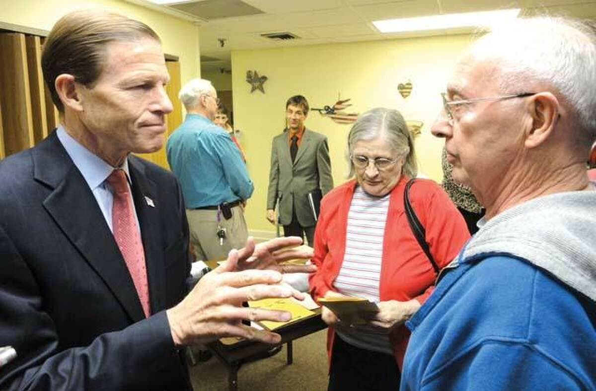 JASON SIEDZIK/ Register CitizenSen. Richard Blumenthal speaks with a Winsted resident concerned about state employee pensions. The former Attorney General met with seniors to discuss scams, as well as Social Security and other issues.