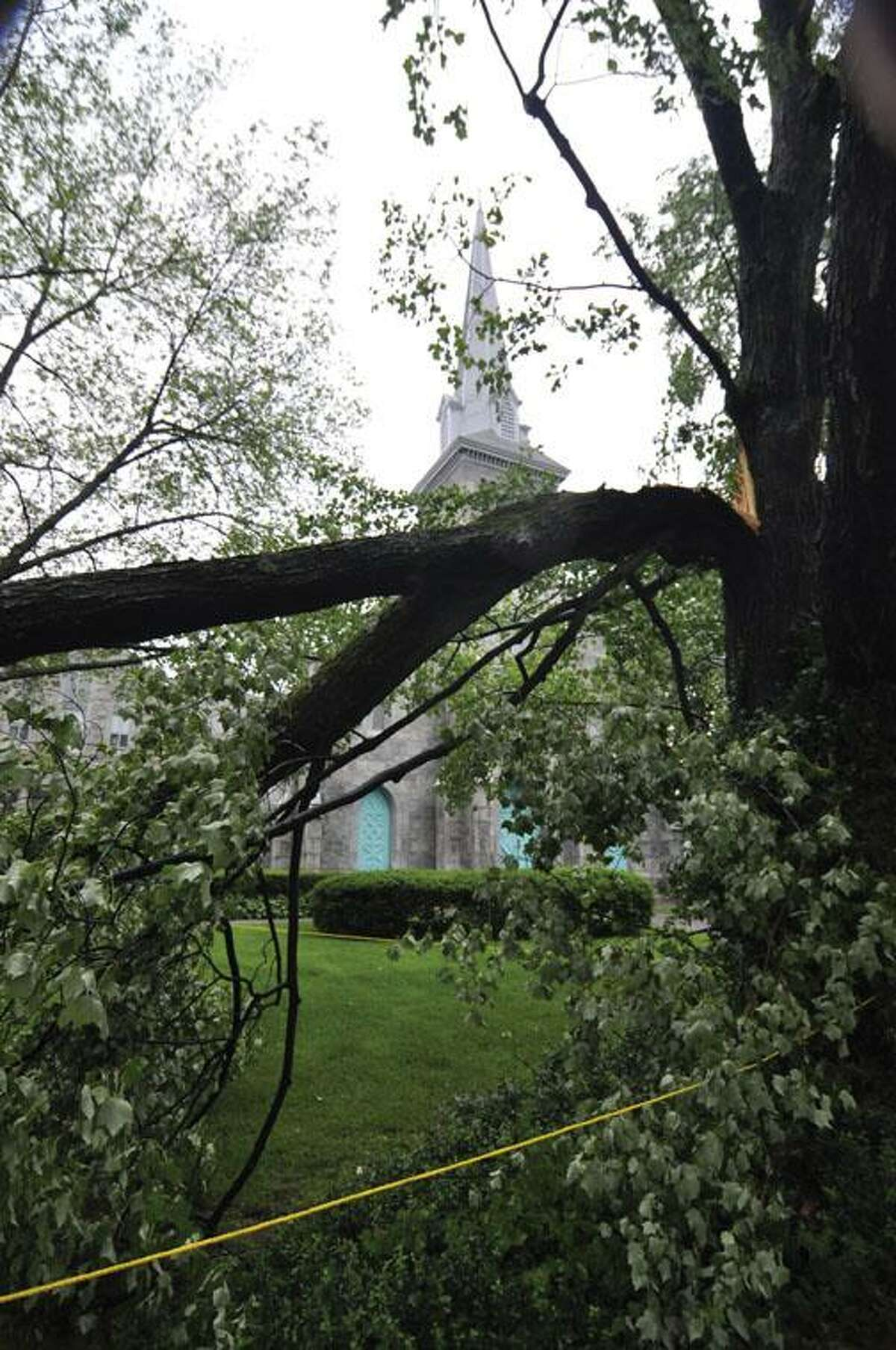 RICK THOMASON / Register CitizenBroken and battered trees sit as a reminder of the fury of Thursday afternoon's storms that blew through Torrington and much of Litchfield County. Two trees were broken on the grounds of Center Congregation Church on Main Street in Torrington.
