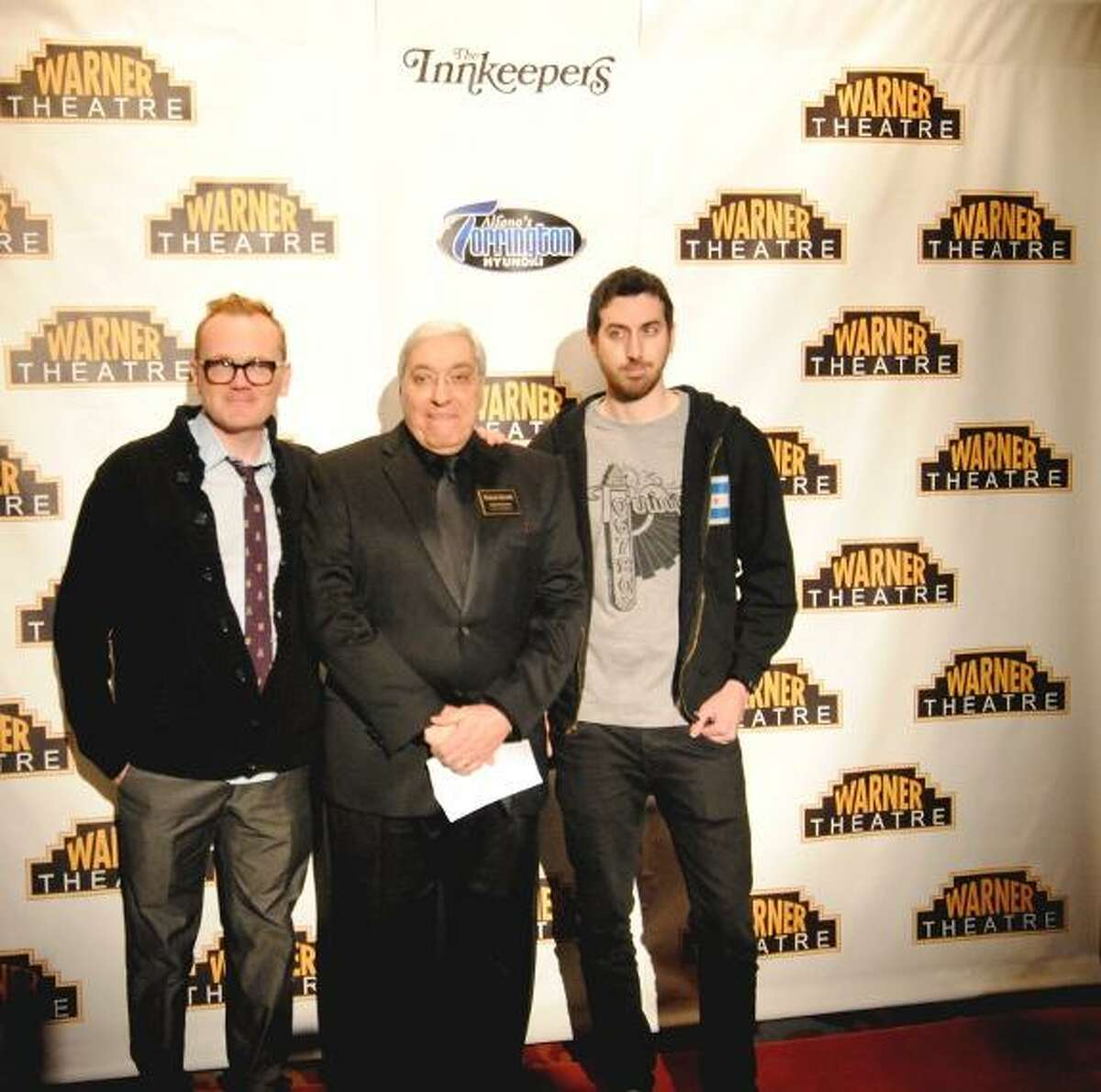 MIKE AGOGLIATI/ Register Citizen Warner Theatre Executive Director John Bonanni, center was joined on the red carpet by star Pat Healy, left and Director Ti West of 'The Innkeepers'.