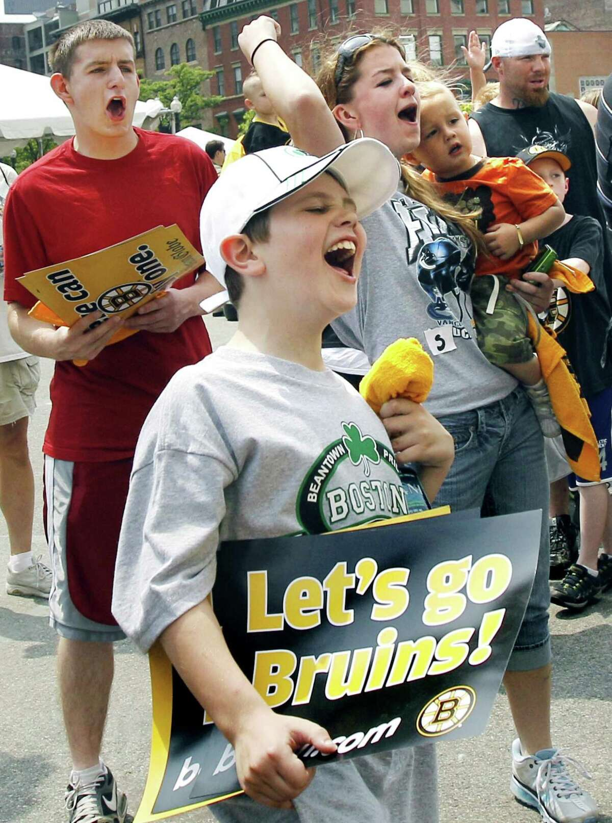 Boston Bruins fans cheer at a FanFest outside the TD Garden in Boston Thursday, June 9, 2011 a day after the Bruins beat the Vancouver Canucks 4-0 in Game 4 of the NHL hockey Stanley Cup Finals. (AP Photo/Elise Amendola)