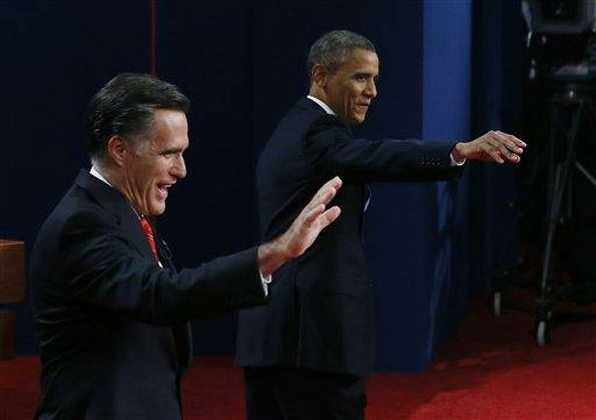 Republican presidential nominee Mitt Romney and President Barack Obama wave during the first presidential debate at the University of Denver, Wednesday, Oct. 3, 2012, in Denver. (AP Photo/Pool, Rick Wilking)