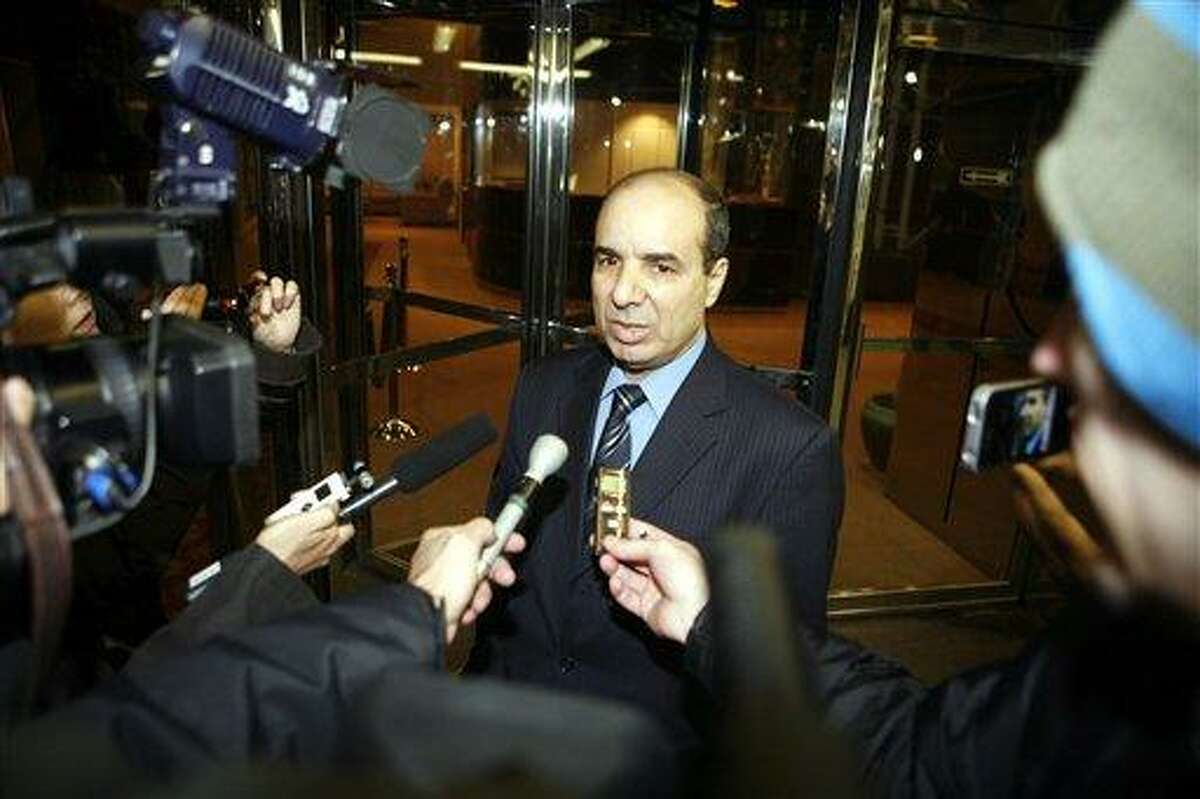 Ibrahim Dabbashi, Libya's deputy ambassador at the United Nations, speaks to reporters at the entrance to the Libyan Mission in New York Monday, Feb. 21, 2011. Dabbashi called Monday for Moammar Gadhafi to step down as Libya's ruler. (AP Photo/David Karp)