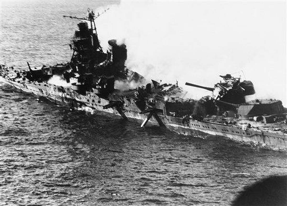 In this June 1942 file photo, a Mogami class Japanese cruiser is the flaming target of carrier-based U.S. naval aircraft in the historic battle of Midway which raged for three days in June 1942. Associated Press file photo