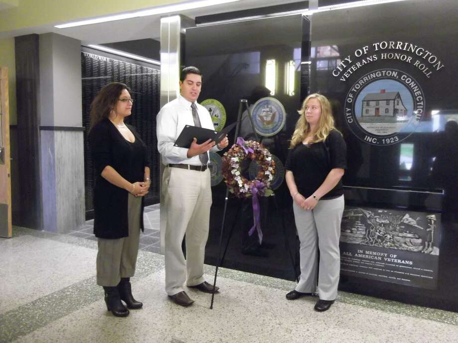 Sarah Bogues/Register Citizen Staff Torrington Mayor Ryan Bingham stood with members of the Susan B. Anthony Project and announced on Monday morning that October is Domestic Violence Awareness Month.