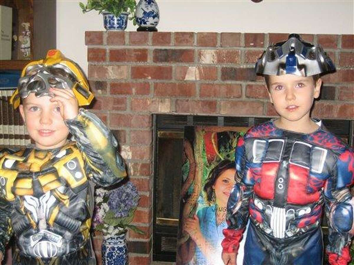 This undated photo provided by Chuck and Judy Cox shows Braden, left, and Charlie Powell. Associated Press