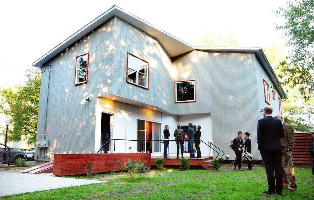 The Vlock Buildiing Project, a two-family house designed and built by Yale architecture students in partnership with Neighborhood Housing Services, on Newhall Street in New Haven was dedicated Monday. Photo by Arnold Gold/New Haven Register